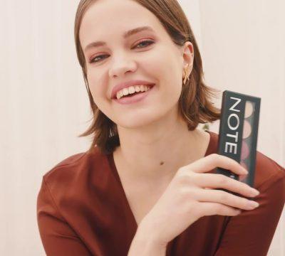 Note model photoshoot warmed toned eye holding professional eyeshadow 107